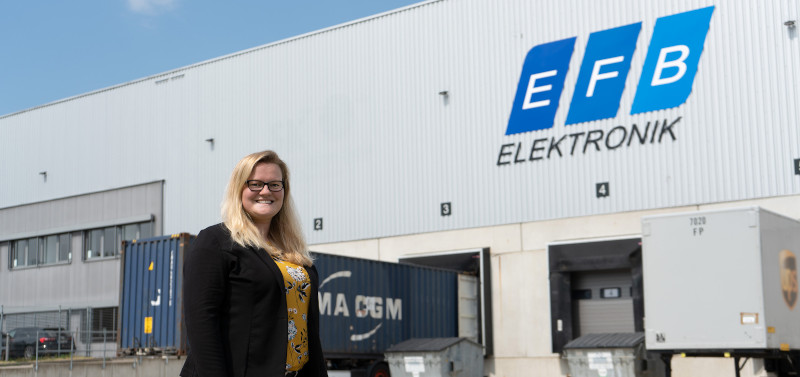 EFB-Elektronik moves into a new logistics center - Stefanie Bühner in front of the warehouse